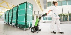 Movexx walk-behind tugger being used in a medical/clean application traditionally handled by manually-pushed carts.